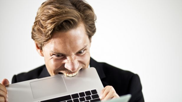 Man Biting Laptop
